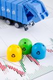 Colored trash bins and garbage truck toys Royalty Free Stock Image