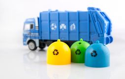Colored trash bins and garbage truck toys Stock Photography