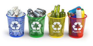 Colored trash bins for recycle paper, plastic, glass and metal i Royalty Free Stock Image