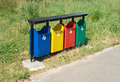 Colored trash containers in a park Royalty Free Stock Images
