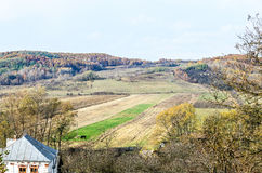 Colored trees in autumn time, Horezu Region. Yellow orange leaves, countryside blue sky Royalty Free Stock Image
