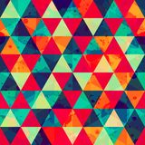 Colored triangle seamless pattern with blot effect stock illustration