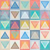 Colored triangle seamless pattern with grunge effect Stock Image