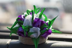Colored tulips in a jute vase. Royalty Free Stock Photos