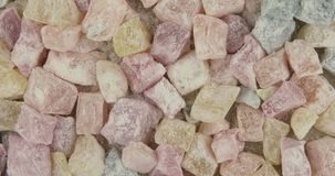 Colored turkish delight sweets coated with icing sugar.  stock video