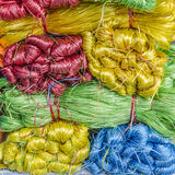 Colored twine. In a street market in Vietnam Stock Photo