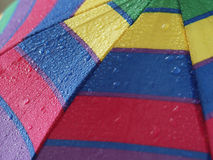 Colored umbrella. With rain drops Stock Images