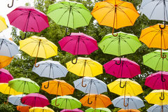 Colored umbrellas in the air. Royalty Free Stock Images