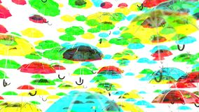 Colored umbrellas background. stock video footage