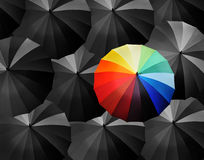 Colored umbrellas on a black background Stock Photo