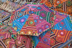 Colored Umbrellas. Brightly colored umbrellas for sale in an Indian market place Royalty Free Stock Photo