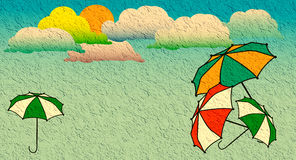 Colored umbrellas and clouds Stock Image