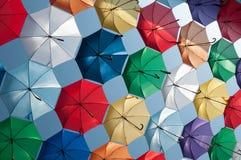 Colored umbrellas oblique view Stock Photos