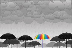 Colored umbrellas in the rain Royalty Free Stock Photo