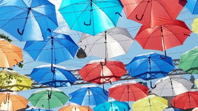 Colored umbrellas stock video footage