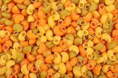 Colored uncooked italian pasta pipe rigate as background Royalty Free Stock Photos