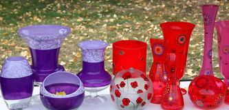 Colored vases. Red and violet on a shelf Stock Photos