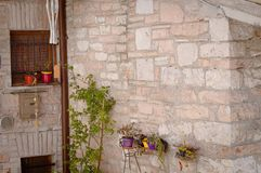 Colored vases on the wall of a  medieval building. Collepino, Umbria, Italy Royalty Free Stock Photos