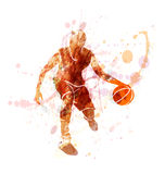 Colored vector silhouette of basketball player with ball Royalty Free Stock Photography