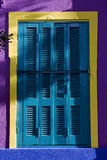 Colored venetian blind and wall Stock Photos