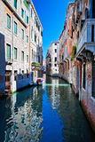 Colored venice canal with houses standing in water Royalty Free Stock Photography
