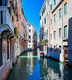 Colored Venice canal with houses in water Stock Photos