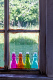 Colored Vintage Bottles on Window Sill Royalty Free Stock Photos