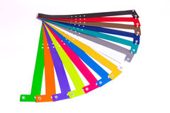 Colored vinyl bracelets on the arm Royalty Free Stock Images