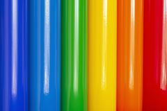 Colored vinyl film in stock. Background of rolls of colored vinyl film stock photo
