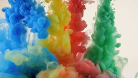 Colored vivid ink in water. Bright colorful background. Slow motion stock footage