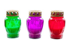 Colored votive candles on white background Stock Images