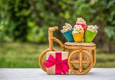 Colored waffle cones and gift box. Popcorn waffle cones and gift box. Festive concept. Holiday sweets royalty free stock photo