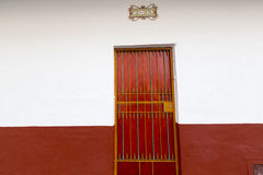 Colored wall and door, colonial architecture in Cali Royalty Free Stock Photo