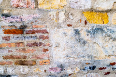 Colored wall made of stone and brick Stock Photo