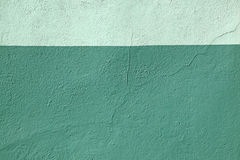Colored wall multi-colored green paint pattern background Stock Images