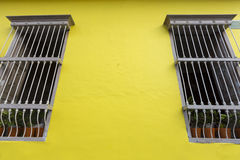 Colored wall and window, colonial architecture in Cali Royalty Free Stock Photo