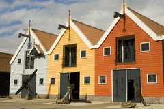 Colored warehouses in harbor. A row of colored warehouses in the harbor in Scandinavian style Royalty Free Stock Image