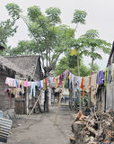Colored washing hanging in asian village street Royalty Free Stock Images