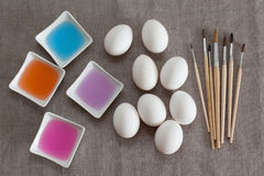 Decoration Easter eggs. Colored water and brushes for decoration Easter eggs Royalty Free Stock Photo