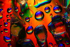 Colored water drops Stock Images
