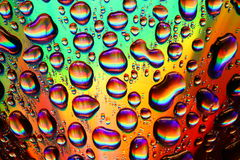 Colored water drops Stock Photography