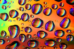 Colored water drops Stock Image