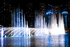 Colored water fountain at night Stock Images