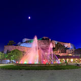 Colored water fountain at night, Corfu Stock Photos
