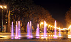 Colored water fountain at night. Royalty Free Stock Photos