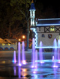 Colored water fountain at night. Royalty Free Stock Photography
