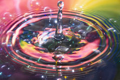 Colored water and water drop splash Royalty Free Stock Photography
