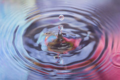 Colored water and water drop splash Royalty Free Stock Photos