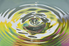 Colored water and water drop splash Stock Photography