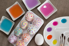 Decoration Easter eggs. Colored water, watercolors, palette, brushes and painted Easter eggs Stock Photography